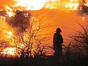 Firefighters battle as the fire rages