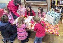 Kids write letters to Santa at Christmas party