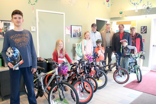The Bikes for Books winners celebrate
