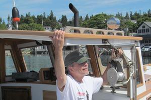 Jeremy Stewart aboard his boat, Miss Robin