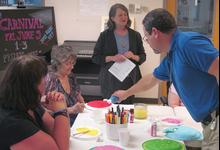 Staff members work with residents