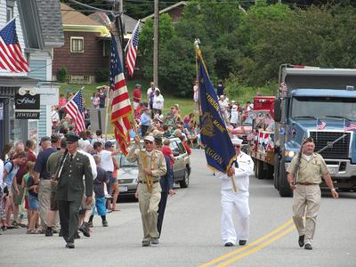 The color guard leads the July 4 parade through Deer Isle