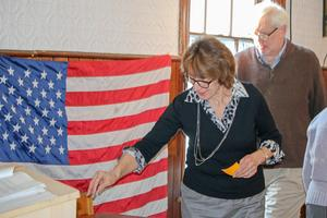 Selectman Donna Brewer casts a ballot