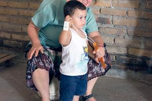 Jackie Pelletier with a young boy in Honduras