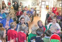 Local students bring holiday cheer to Island Nursing Home