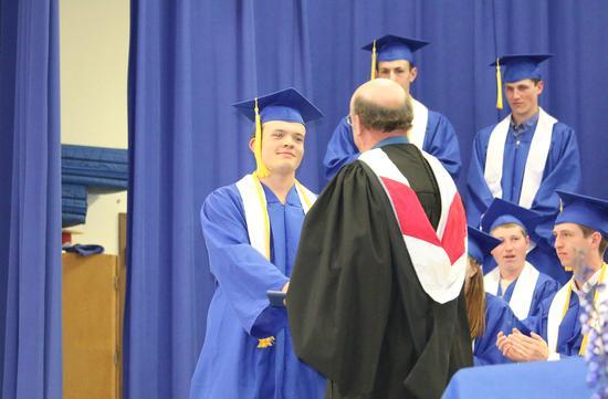 A diploma and a handshake
