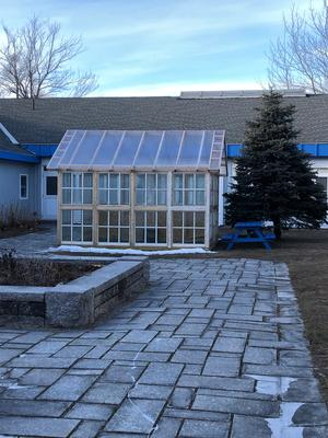 A brand new greenhouse has been installed in the outdoor common area.