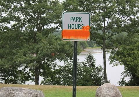 Sign vandalized in Blue Hill park