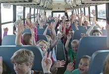 Students and staff at Brooksville Elementary School on the new bus