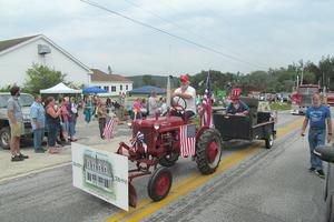 Old farm tractors appear in the parade.