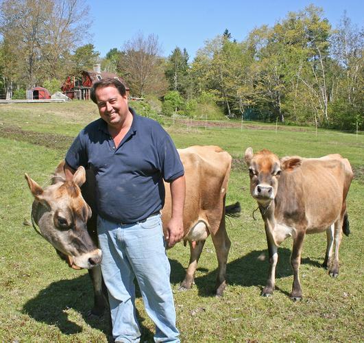 """""""Farmer"""" Dan Brown and his cows"""