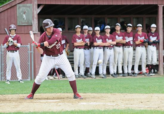 The Eagle's Cooper Smallidge swings against Mattanawcook