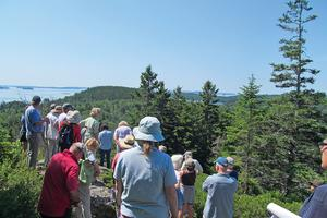 Hikers at the top of John B. Mountain in Brooksville, Maine