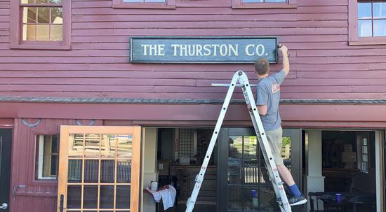 Matt Thurston hangs the original sign