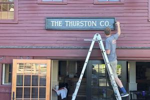 Matt Thurston hangs the original sign