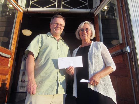 Karen Stanley presents a grant check to Matt Murphy