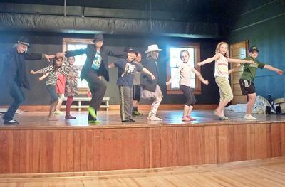 Adams School players rehearse