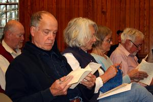 Castine residents peruse warrant articles at town meeting