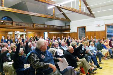 Castine citizens vote at a special town meeting