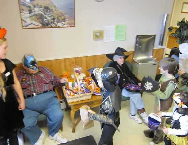 Multi-generational trick-or-treat brings students to PNH Residents