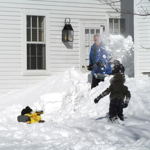 Del Davis has help digging out his front door