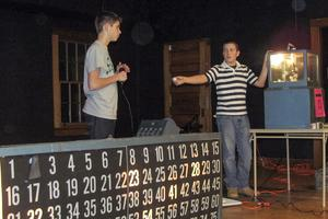 Tyler McKenney and Drake Janes run Bingo at Emerson Hall in Castine