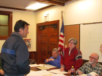 Doug Koos shows latest site plan to Castine Planning Board