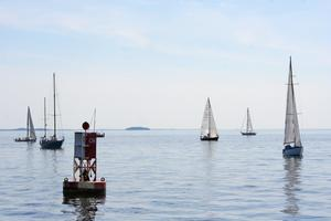 Twenty-seven boats circle around the Castine Harbor Bell