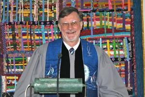 Mark Worth in the pulpit