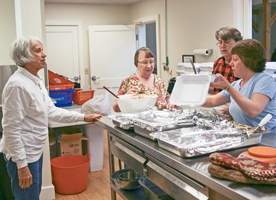 Deer Isle volunteers prepare supper at St. Brendan's