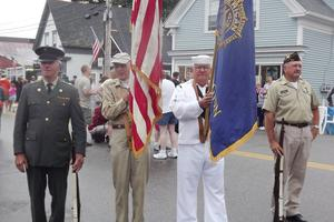 The color guard at the head of the parade