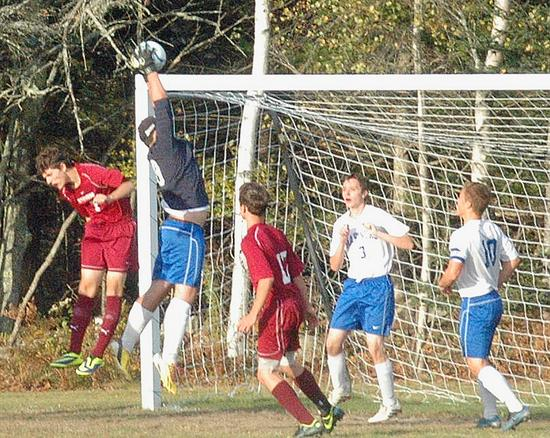 DISHS soccer goalie Ethan Shepard saves high