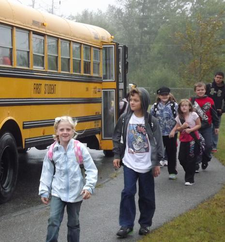 Students piled off buses and spilled out of parents' cars