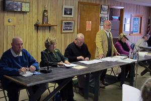 Deer Isle selectmen and moderator at town meeting