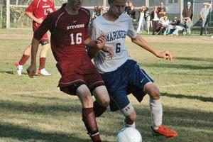 Curtis Farrin fights for control of the ball