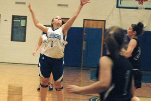 Mariner Haley Brewer tips the pass