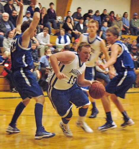 Connor Morey drives through against Searsport