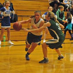 Julie Hutchins drives the ball