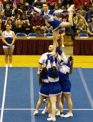 DISHS cheerleaders perform a stunt
