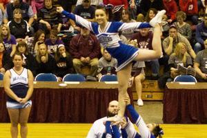DISHS cheerleaders perform a stunt