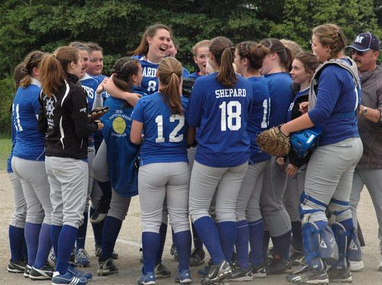Sydney Ouzts is congratulated by her teammates