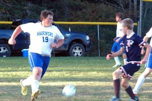 Hayden Torrey charges down the field