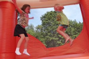 Marlena Jones and Grace McGuire enjoy the giant inflatable bounce house