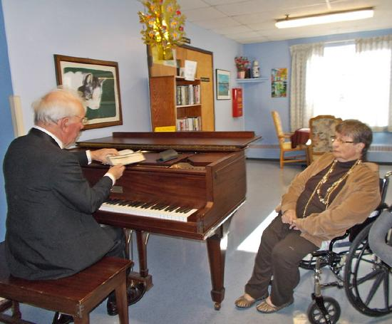 Gerald Wheeler entertains resident Marion Bauman