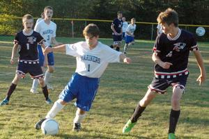 Freshman Liam Griffith stays in control of the ball