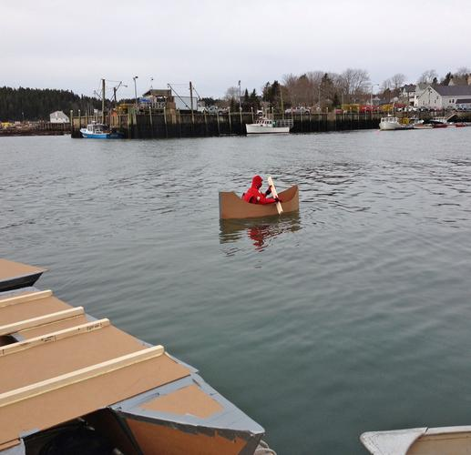Jon Parker tries out his canoe-style cardboard boat