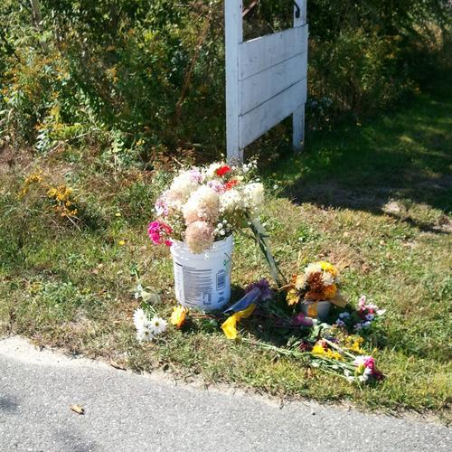 Flowers mark a memorial