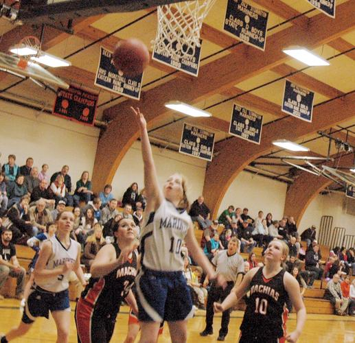 Holli Boyce of the Mariners goes for layup against Machias