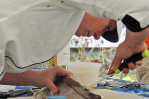 Aragosta chef Devin Finigan takes part in the Seafood Throwdown