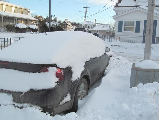 A car yet to be cleaned off sits in the Stonington Post office